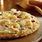 Pizza met scampi's, boursin en venkel